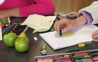 Hands creating artwork