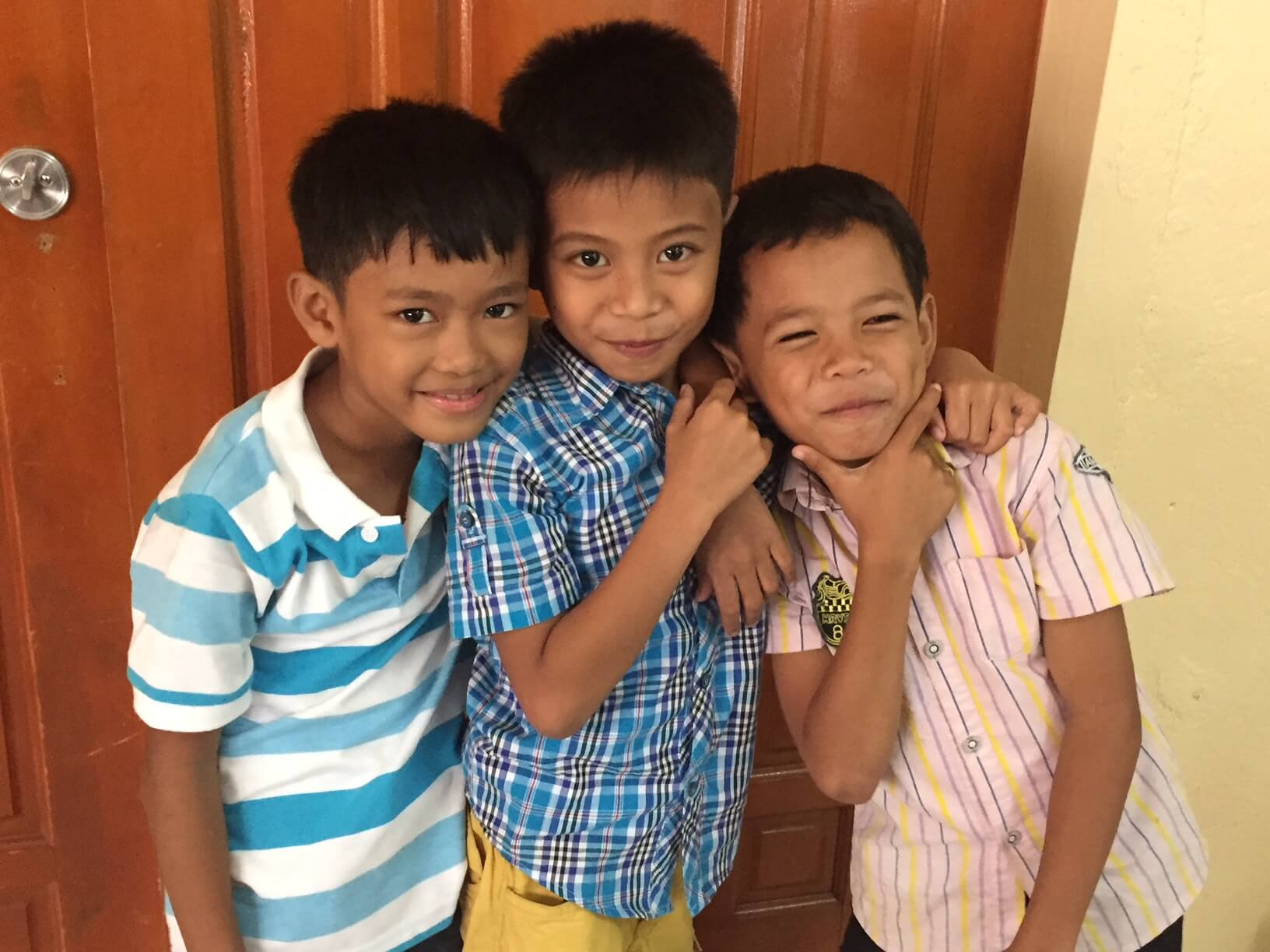 3 boys from the Phillipines smiling